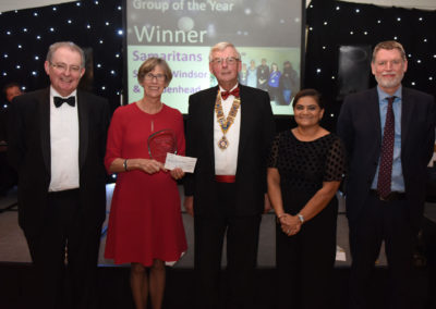 Image of 2019 Group of the Year, Winners, Samaritans Slough, Windsor & Maidenhead Presented by Alan Sinclair & Dr Jim O'Donnell, CCG. £1000 donated by the Rotary Club of Slough, presented by Chairman Richard Mingard